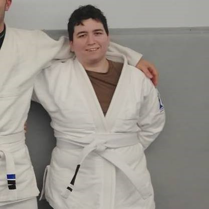 Courtney Johnson smiling in Jiu-Jitsu uniform