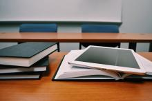 Image of books and tablet