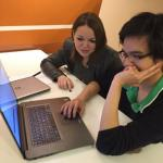 Anh Le and Lidia Tagliafierro work on their team's survey.